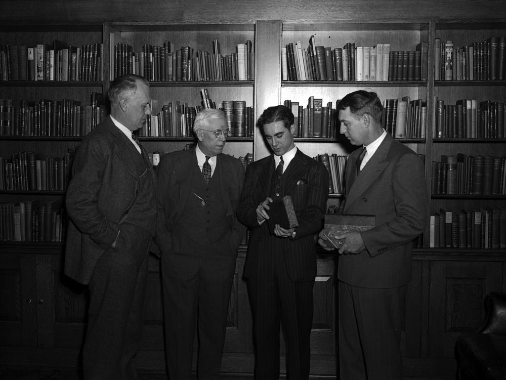 Photograph of Cecil K. Byrd and three scholars in the Lincoln Room at its dedication on February 13, 1943.