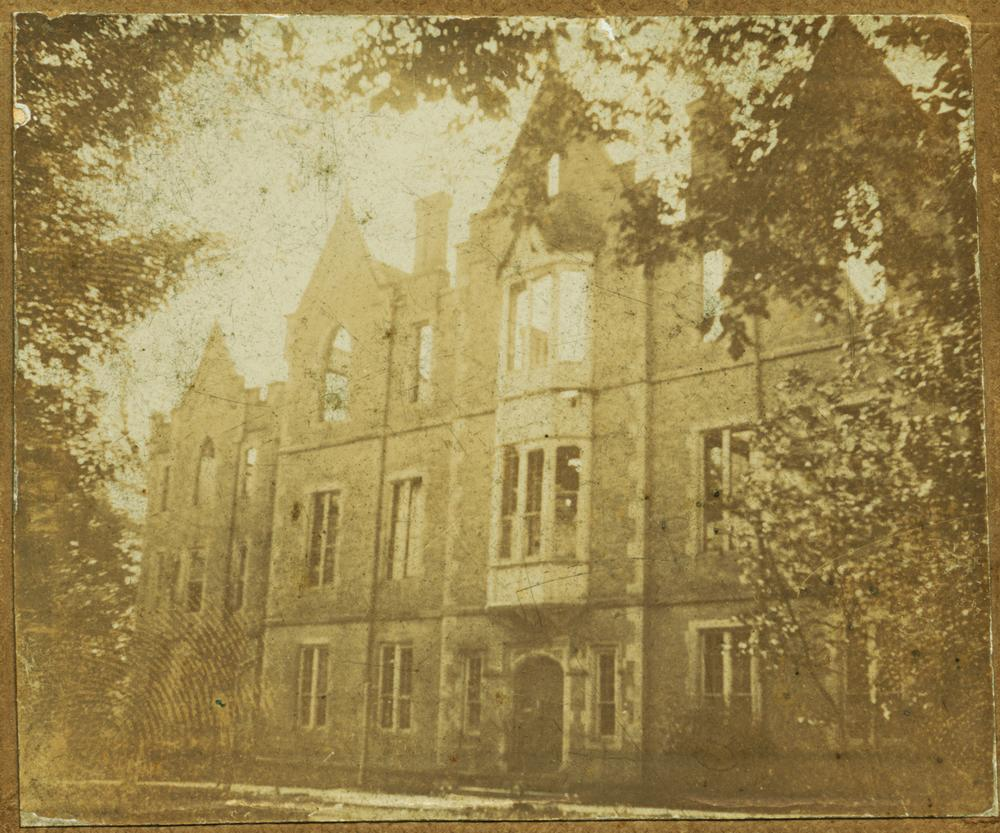 1900 photograph depicting the First University Building.