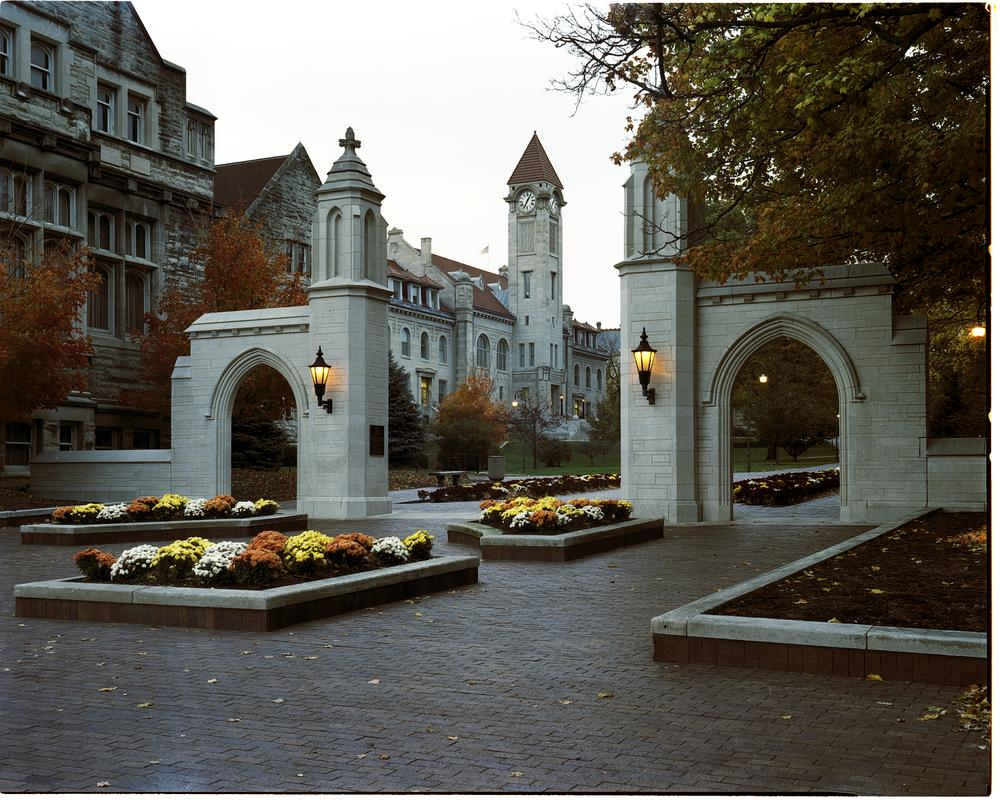 Fall view of Kirkwood, the red brick road and sample gates surrounded by fall flowers.