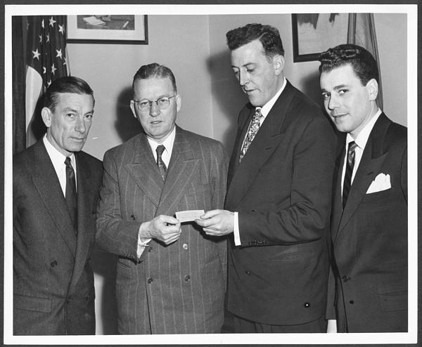 Hoagy Carmichael standing with unidentified men.