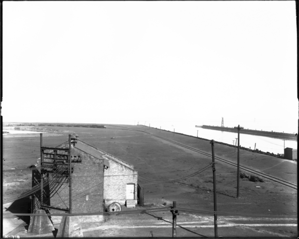 Harbor, Looking from End of Ore Yards, Toward Air Compressor House, Showing Lighthouse in Distance