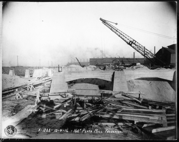 """Looking S.E. at 160"""" Plate Mill W. Wall of Fin. end and N. and S. Works. Excavation for Shears"""