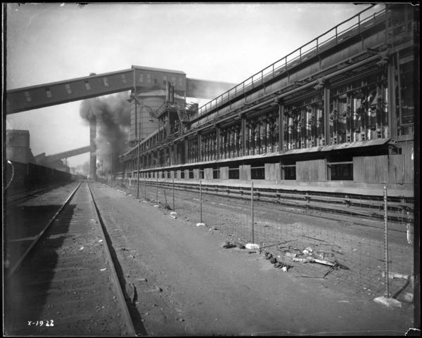Coke Plant, Looking N.W. at Coke Being Pushed from #6 Battery
