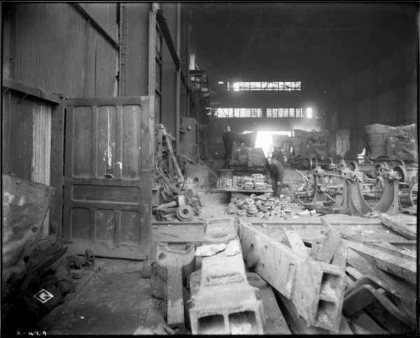 Ladle Repair Shop. View Looking North into South End of Ladle Repair Shop Showing Piece of Scrap Stock on Panel of Door, Also Two Other Pieces Laying on Casting