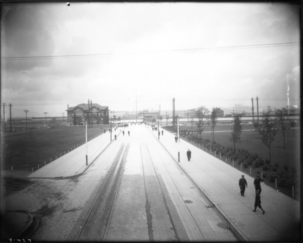View Looking N. from Broadway Bridge of E.J. and E.Highline Showing Men Coming from Mill at Noon