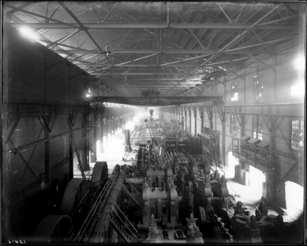 Rail Mill. View from West Track of Pit Crane Looking West at Interior of Mill