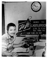 Deejay Eddie Castleberry seated in control room at WMBM