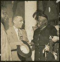 Mary Jane McLeod Bethune, American educator and civil rights leader, converses with             guests during a 1952 event honoring President Tubman's inauguration